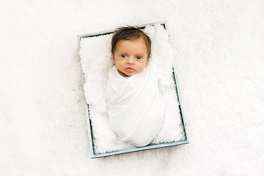Newborn boy in crate