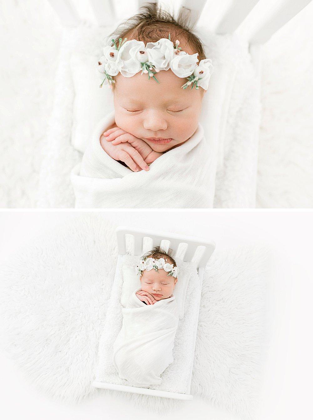 Baby girl in white newborn bed