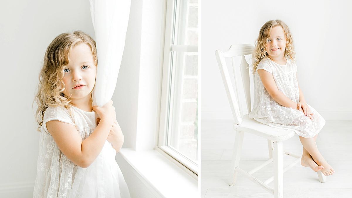 Toddler girl in white studio