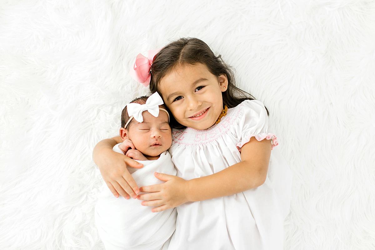 Older Child with Newborn Posing