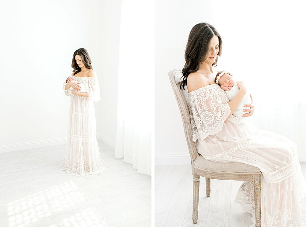 Pretty mom in lace dress holding baby